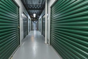 Storage doors. Building interior.Industrial storage in the city. Green doors.