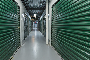 Storage doors. Building interior.Industrial storage in the city. Green doors.