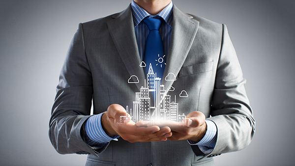 Close up of businessman holding city model in hands