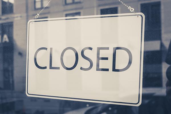 closed sign in shop entrance door