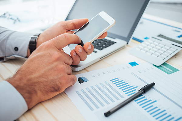 Businessman using a financial app